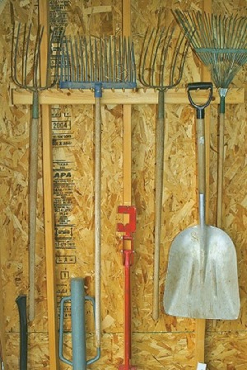 The trick with organizing barn tools is to hang them up rather than piling them in a corner.