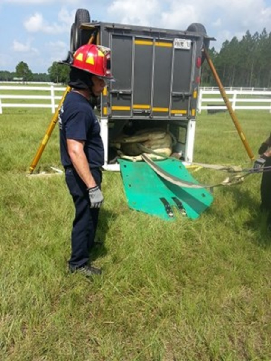 Credit: REBECCA GIMENEZ PHOTO In this training scenario, a trailer has been flipped onto its roof. The mannequin is being removed using a Rescue Glide, which would protect the horse in the event of a real accident.