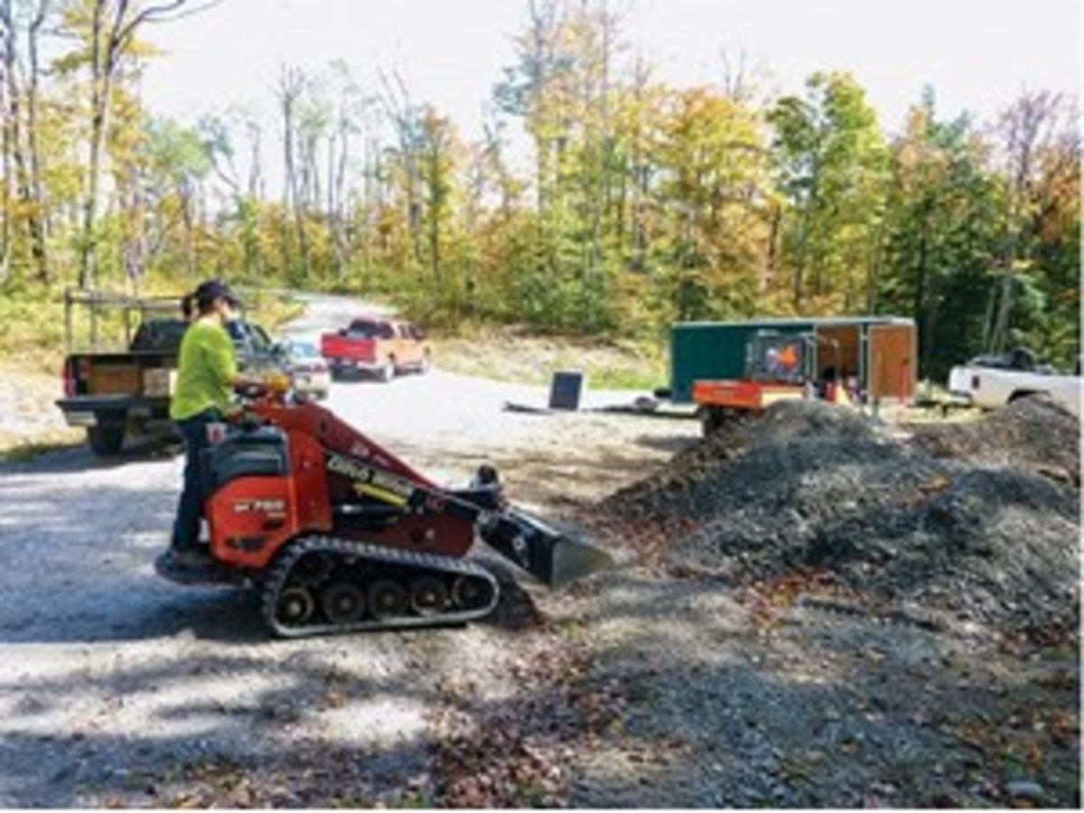 Credit: Marc Geise A volunteer from Lou Eibl Corral moves gravel using a Ditch Witch.