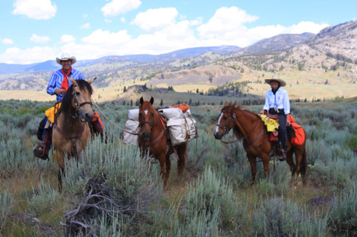 """""""All gear and tack for you and your horse should be comfortable, practical, durable, and as light weight as possible, particularly for your pack horse,"""" note Kent and Charlene Krone, shown here packing into the backcountry of Wyoming's Yellowstone National Park."""