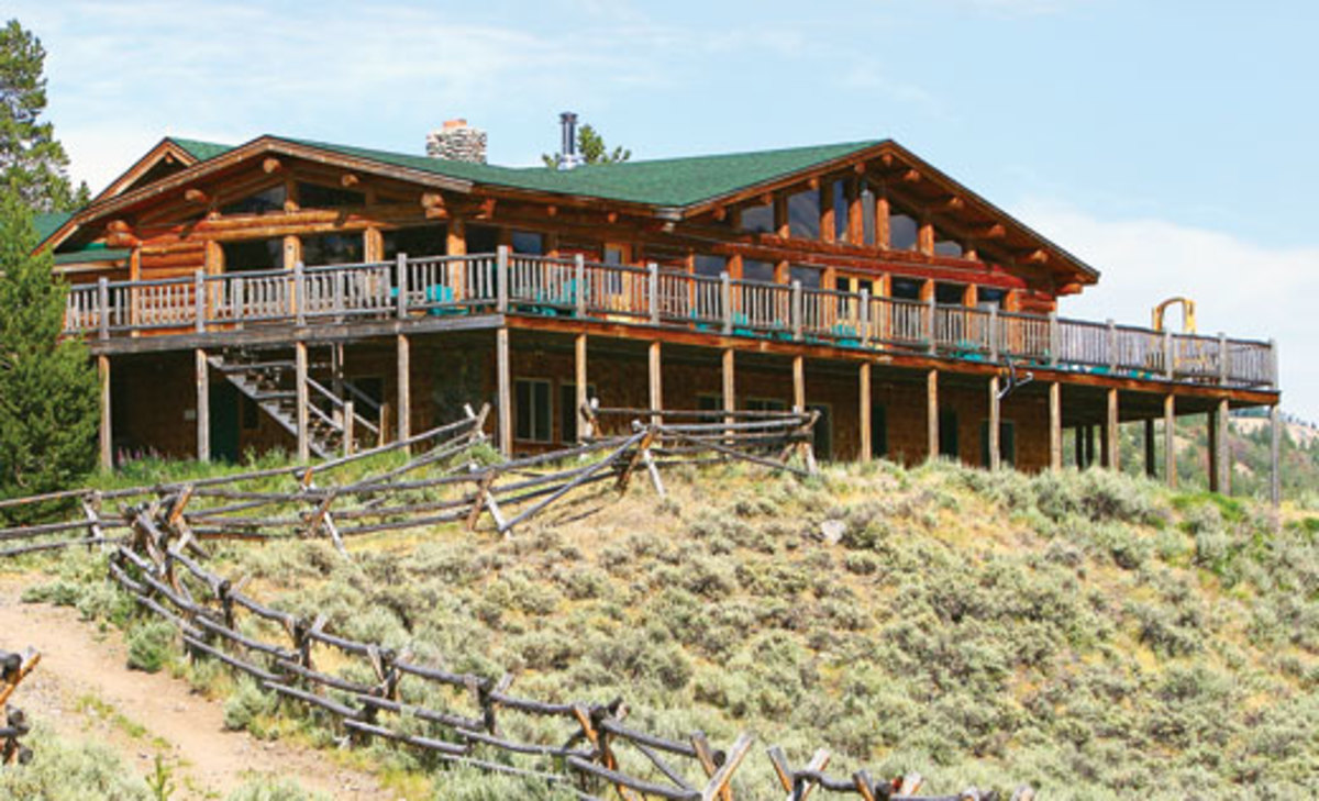 "Triangle C Ranch's main lodge overlooks the Wind River. ""The comfortable log lodge is welcoming in both its d?cor and majestic mountain views,"" write Kent and Charlene Krone"