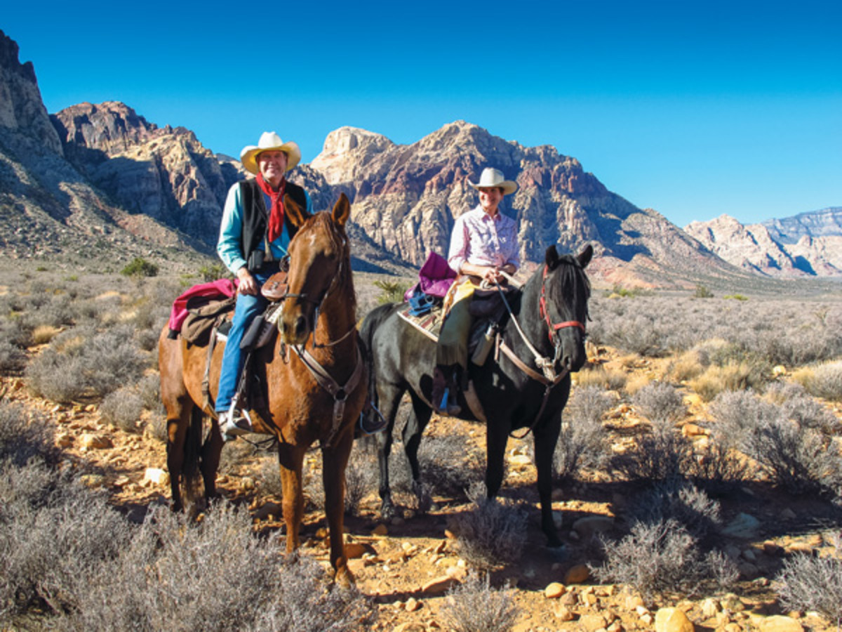 Kent and Charlene Krone ride their Missouri Fox Trotters, Cowboy and Nate, in the Oak Creek Canyon portion of the Red Rock Canyon National Conservation Area. Behind them is the 24,997-acre Rainbow Mountain Wilderness, managed by the Bureau of Land Management. We did an easy 5-mile loop, taking time  to enjoy the fiery red cliffs and varied terrain, report the Krones.