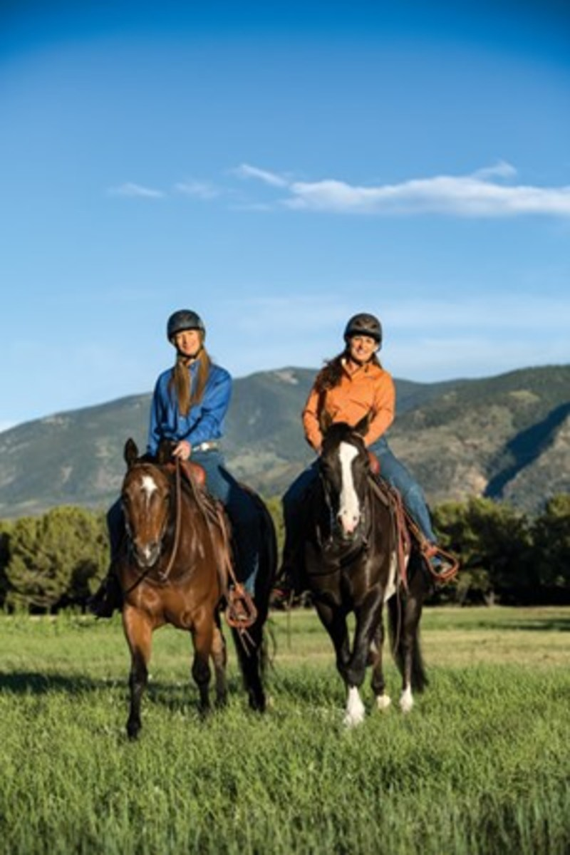 On the trail, your reins need to be safe and functional, and help your horse quickly and easily understand the slightest cue. Here, top trainer/clinician Julie Goodnight will help you choose the reins that are right for you. Shown are Goodnight (right) and Twyla Walker Collins riding with split reins.